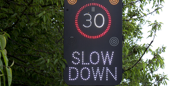 slow down 30 speed limit road sign